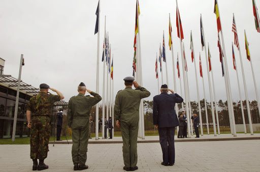 body-NATO-soldiers-saluting-flags