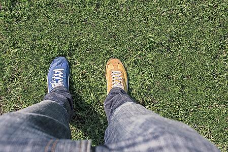 body-different-shoes-yellow-blue
