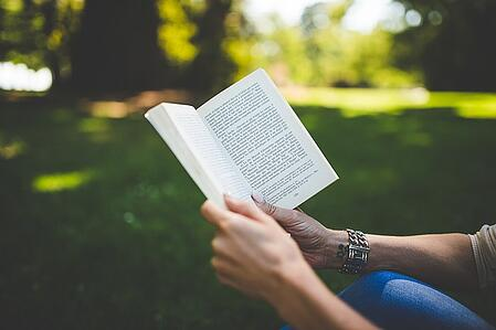 body-reading-book-outside