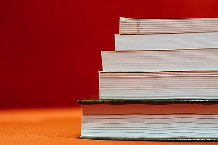 body-stack-of-textbooks-red