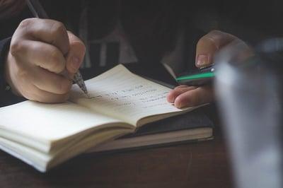body-take-notes-notebook-pen