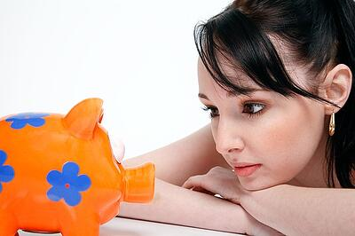 body-woman-looking-at-piggy-bank