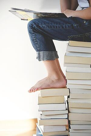 body_student_pile_of_books-1