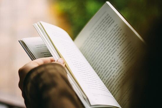 feature-over-shoulder-reading-book