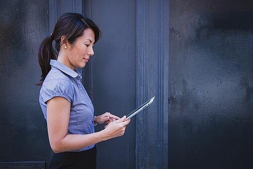feature-woman-holding-ipad-1