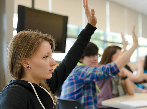 feature_students_raising_hands