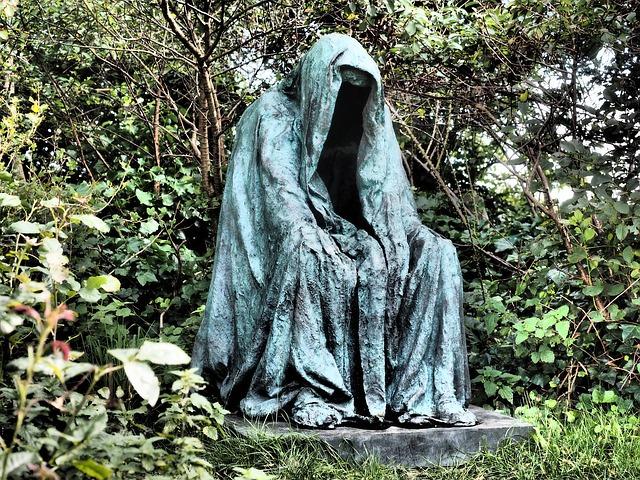 body_depressed_statue_cemetery.jpg